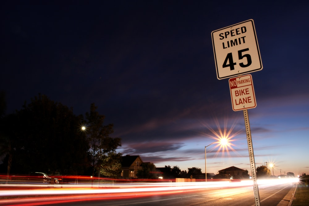 time lapse photography of speed light signage beside road