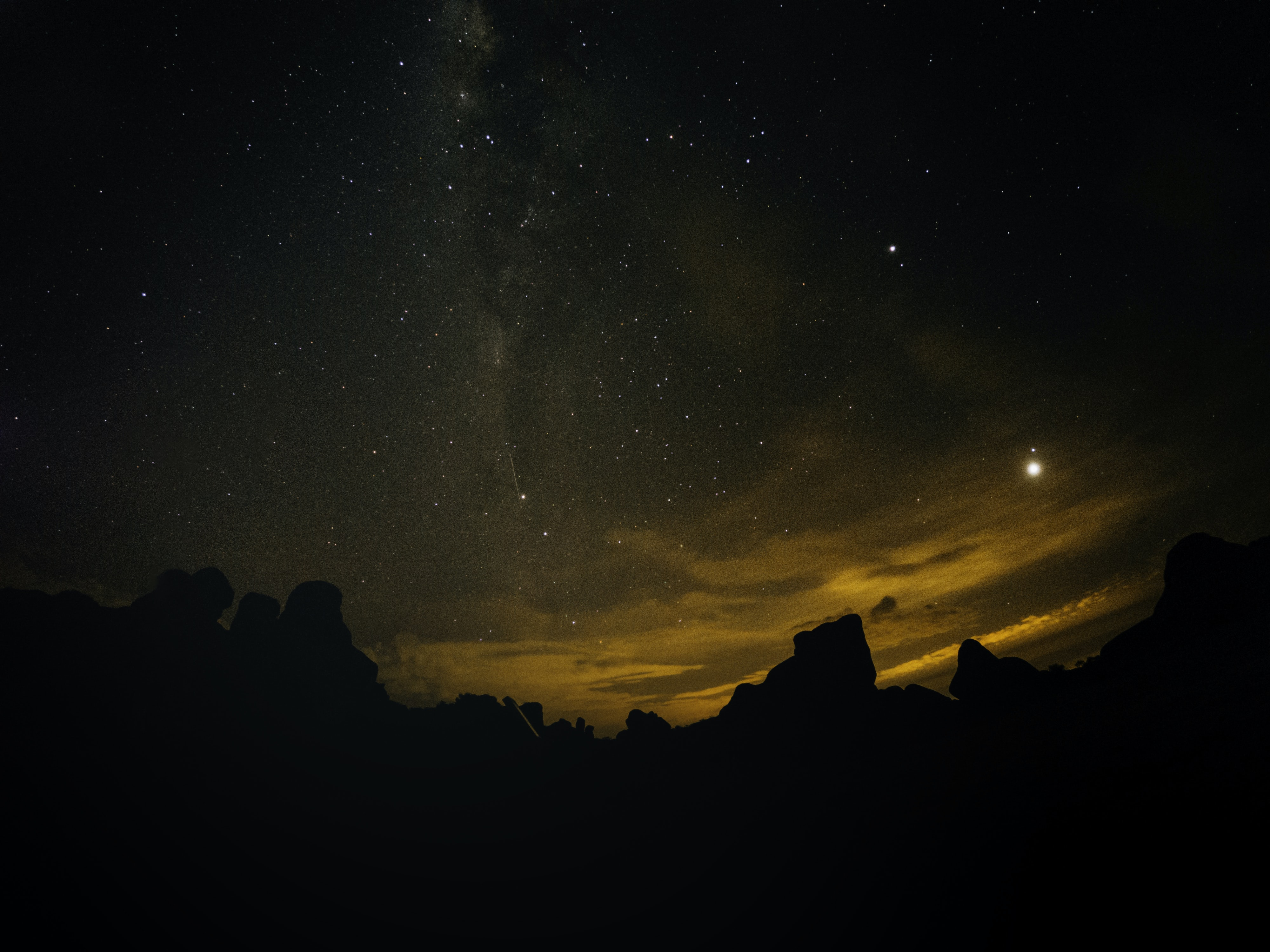 silhouette of mountains at nighttime