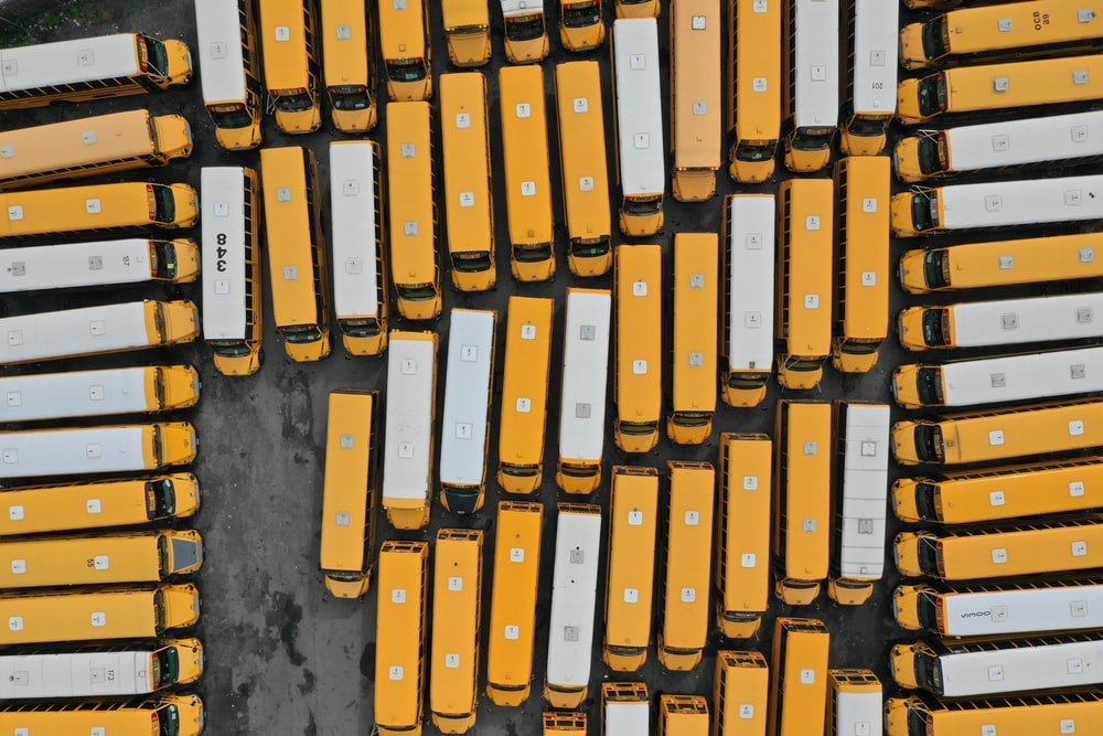 aerial photography of white and yellow buses
