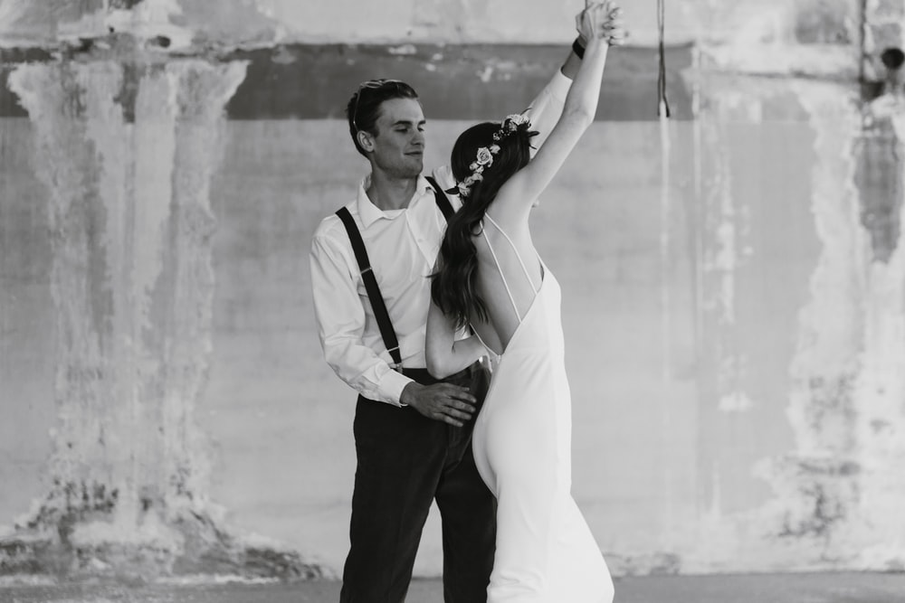 grayscale photography of man and woman dancing
