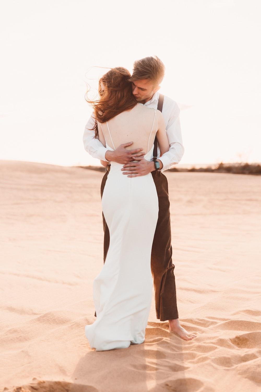 couple hugging on desert sand