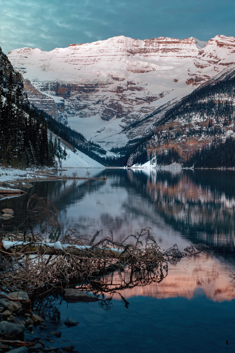 panoramic photography of snow-covered mountain near lake during daytime