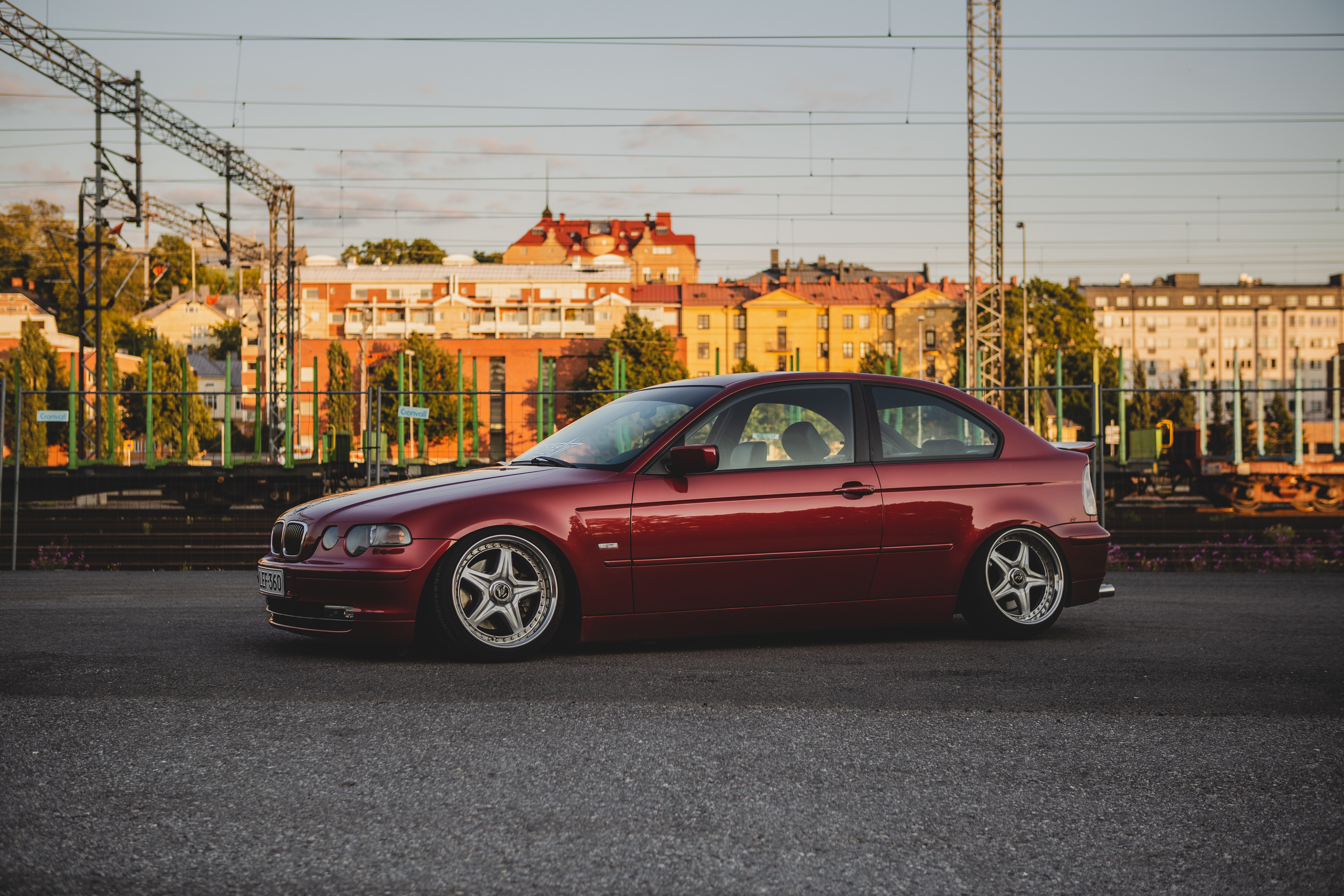 red BMW 3 series E46 coupe on road