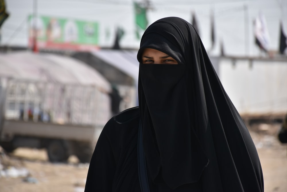 focus photography of women wearing black niqab