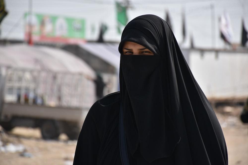 focus photography of women wearing black niqab