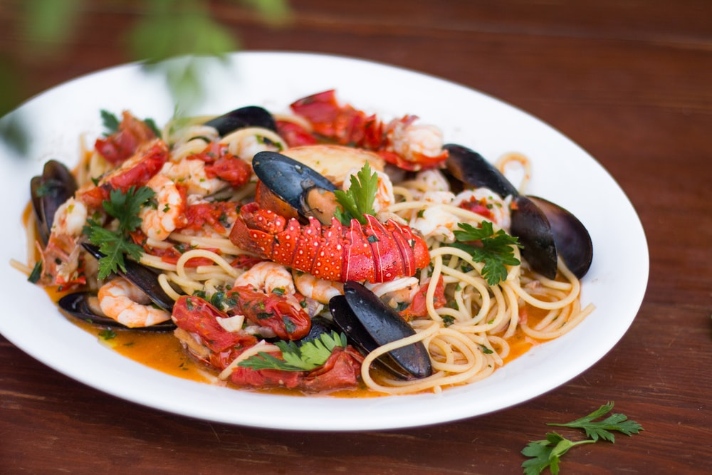 seafood pasta dish in white plate