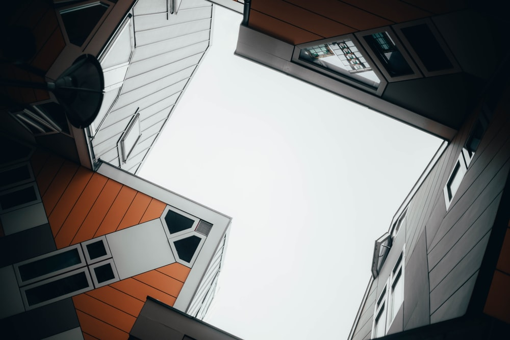 brown and white buildings in low-angle photography