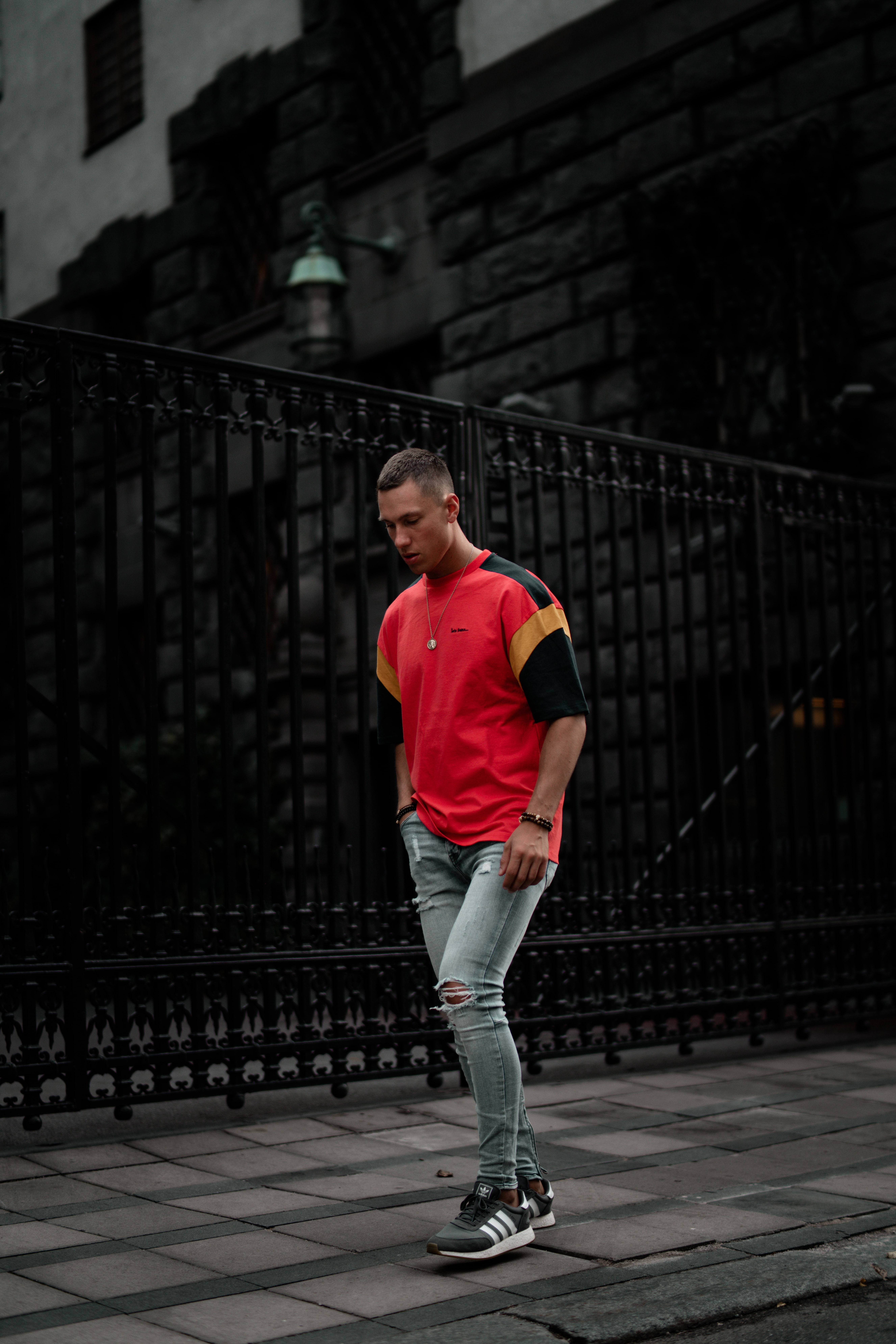 standing man wearing red and black t-shirt