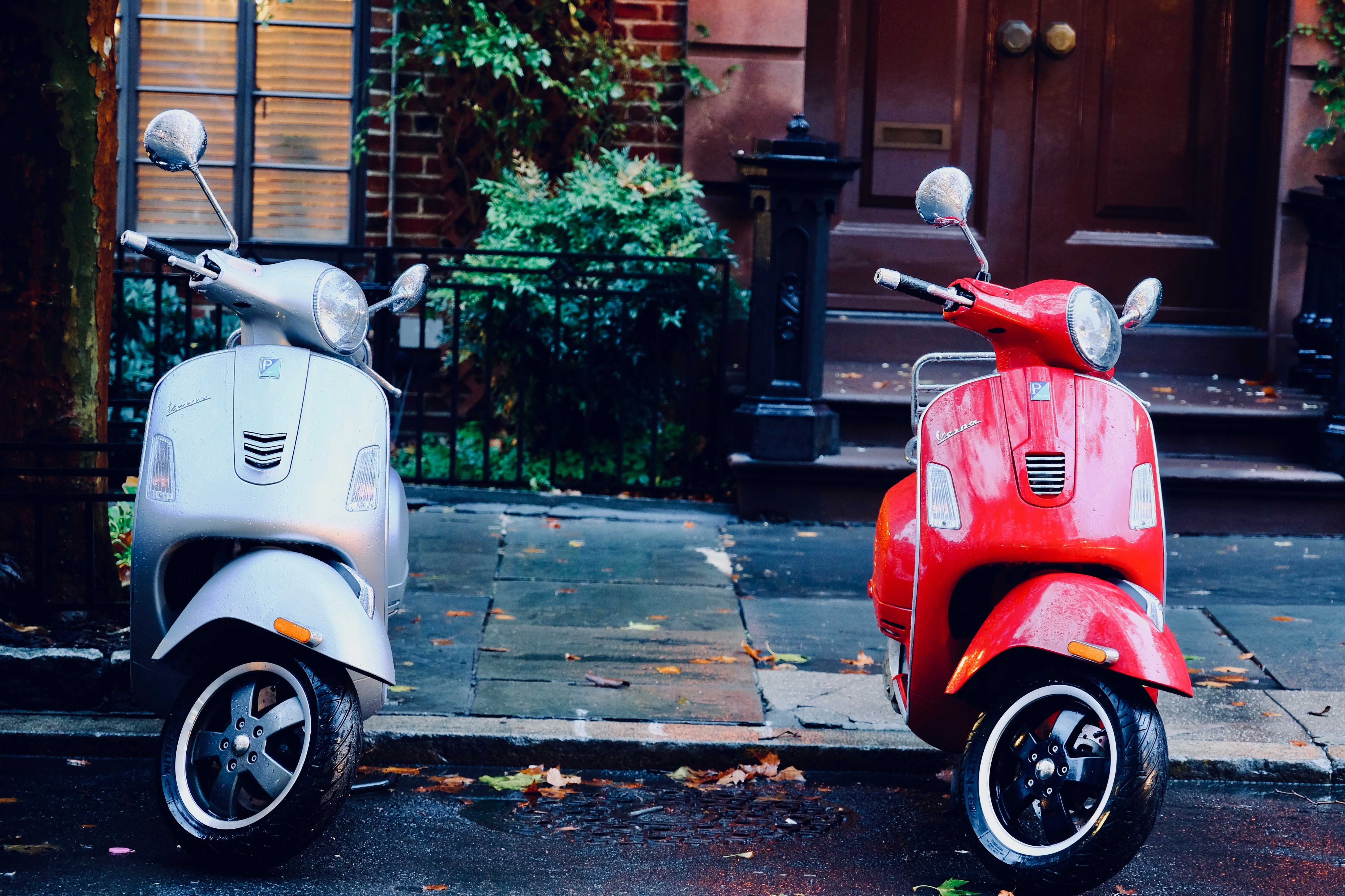 white and red motor scooters parked side-by-side
