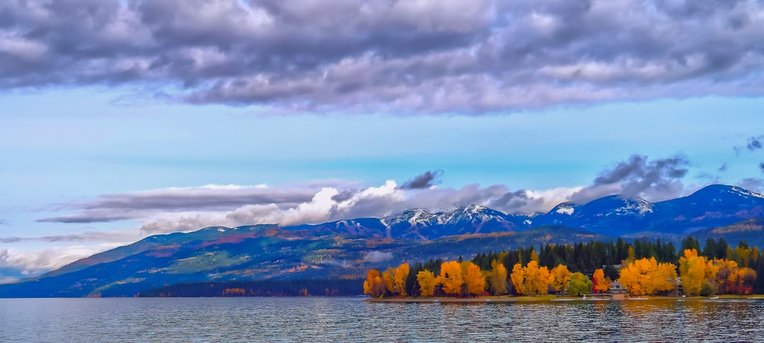 This photo was taken from the shore of Whitefish Lake, Whitefish,Montana.  The first early snow on the peaks shows the ski runs of Whitefish Ski Resort.    To learn how to take pictures like this, read my educational blogs at www.sharetimsphotos.com.