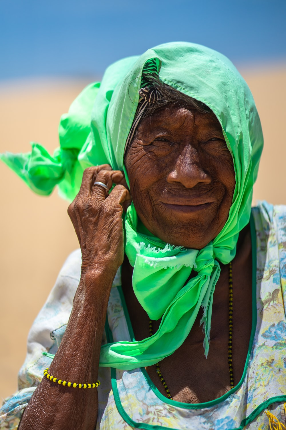 old woman standing and smiling