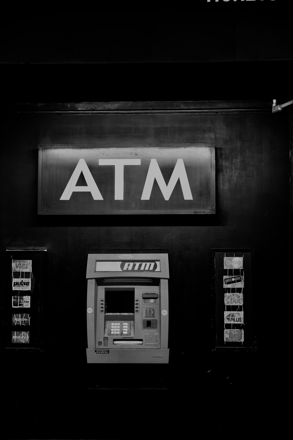 grayscale photo of ATM machine