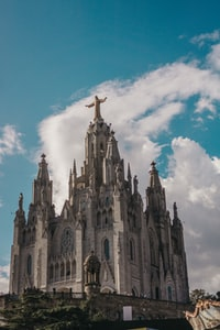 cathedral under white clouds