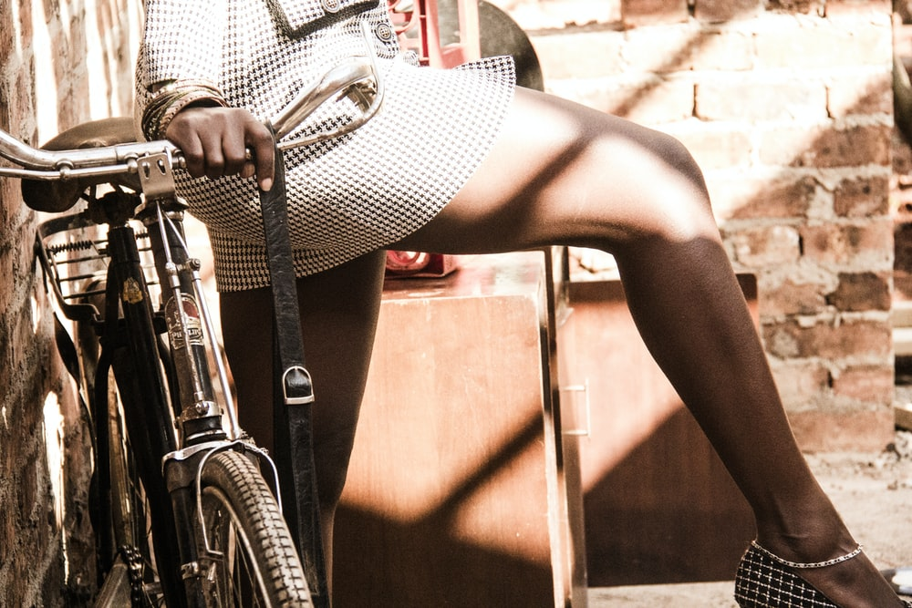 woman standing beside bicycle