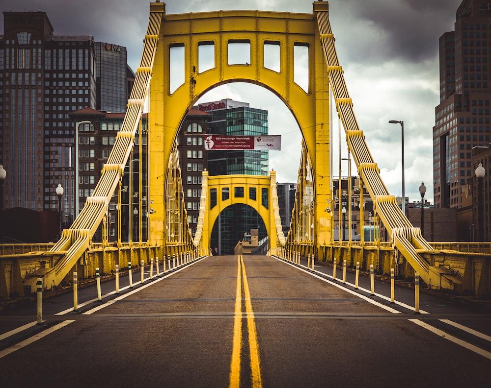 empty yellow and gray concrete bridge
