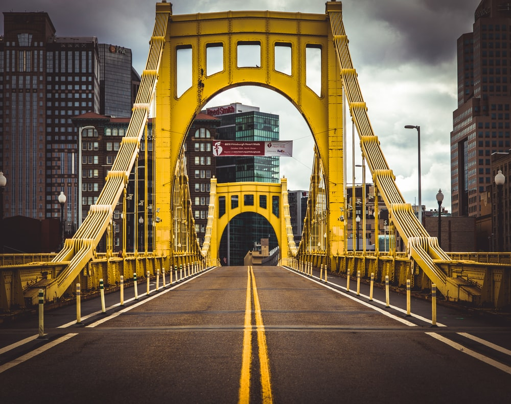 empty yellow and gray concrete bridge