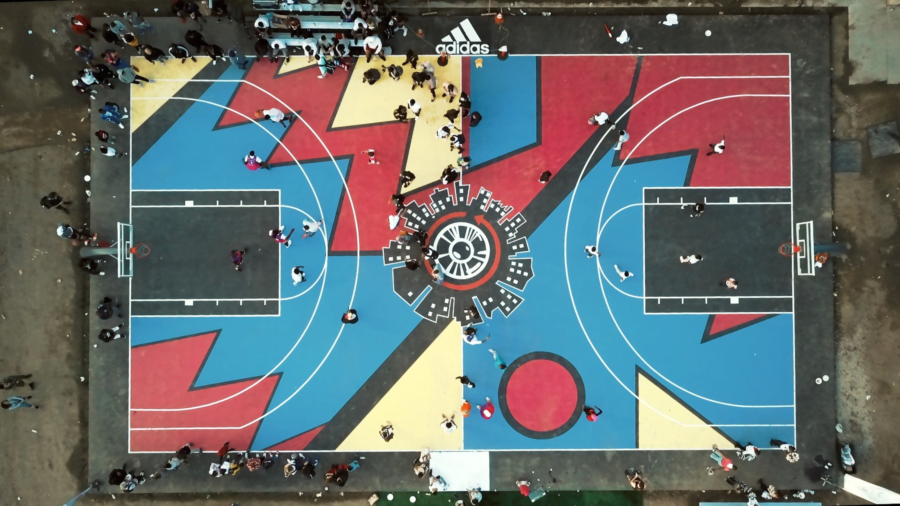 aerial photography of blue, red, and white basketball court