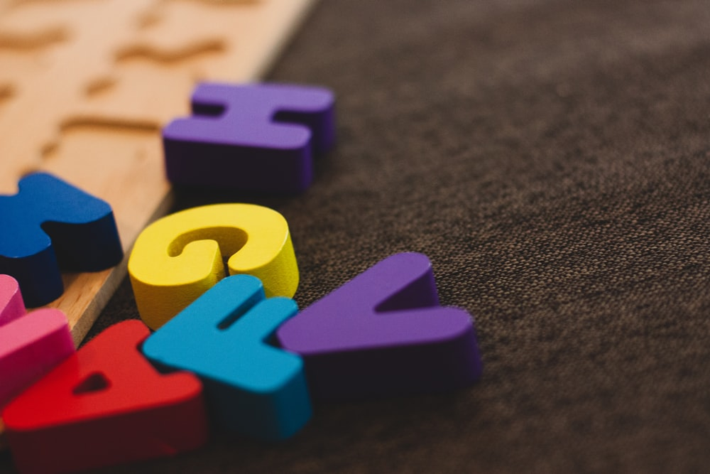 alphabet learning toy on gray apparel