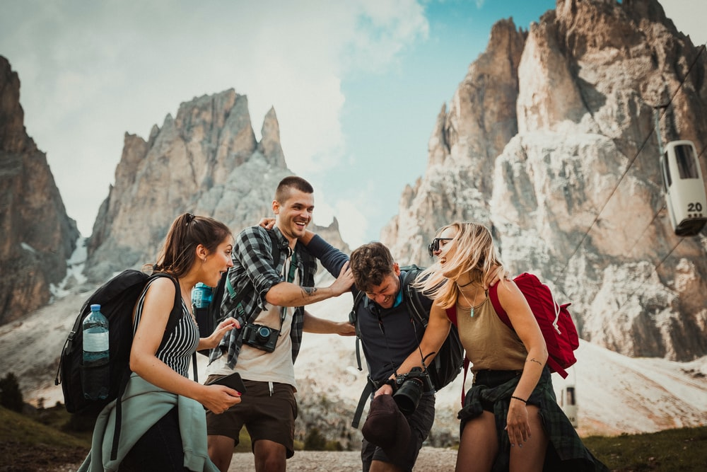 low-angle photography of two men playing beside two women