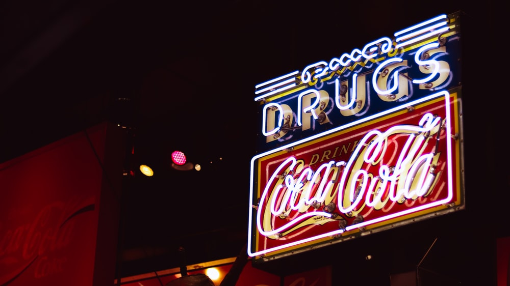 Drugs Coca-Cola neon sign at night time