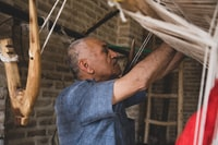 man man standing while weaving swing