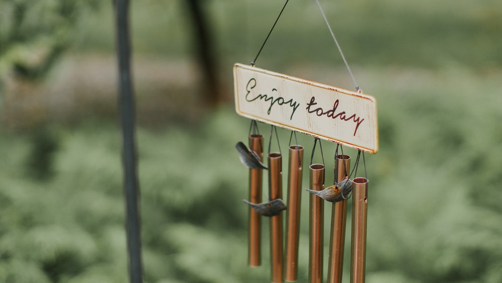 brown and gray wine chime with enjoy today text
