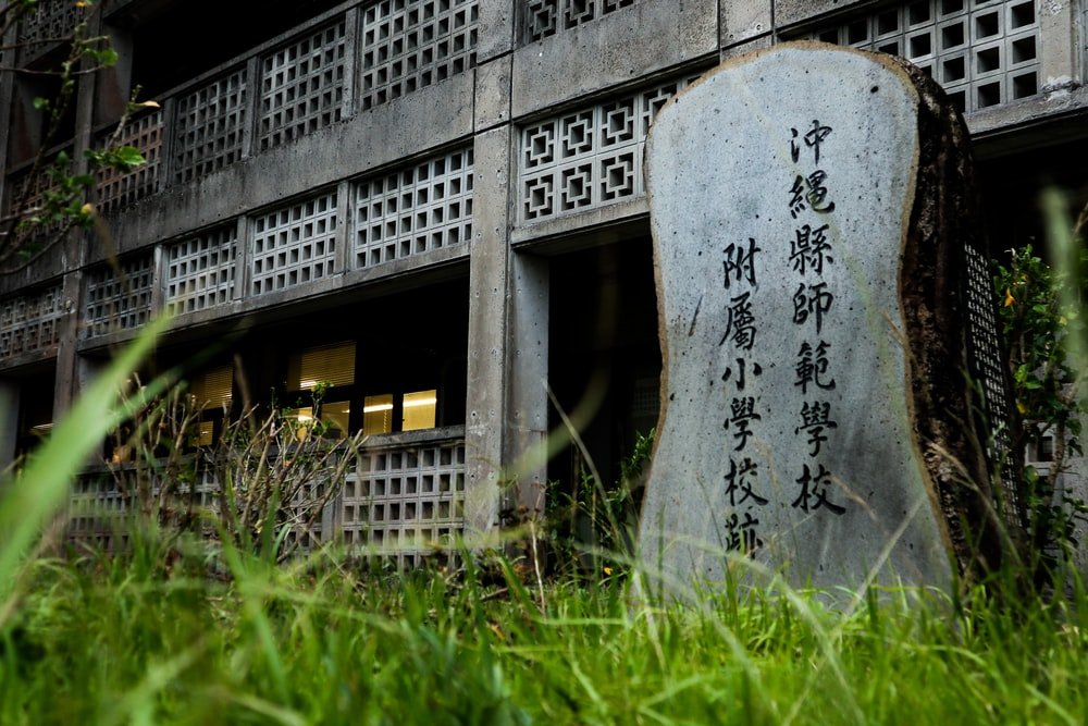 gray concrete tombstone on green grass