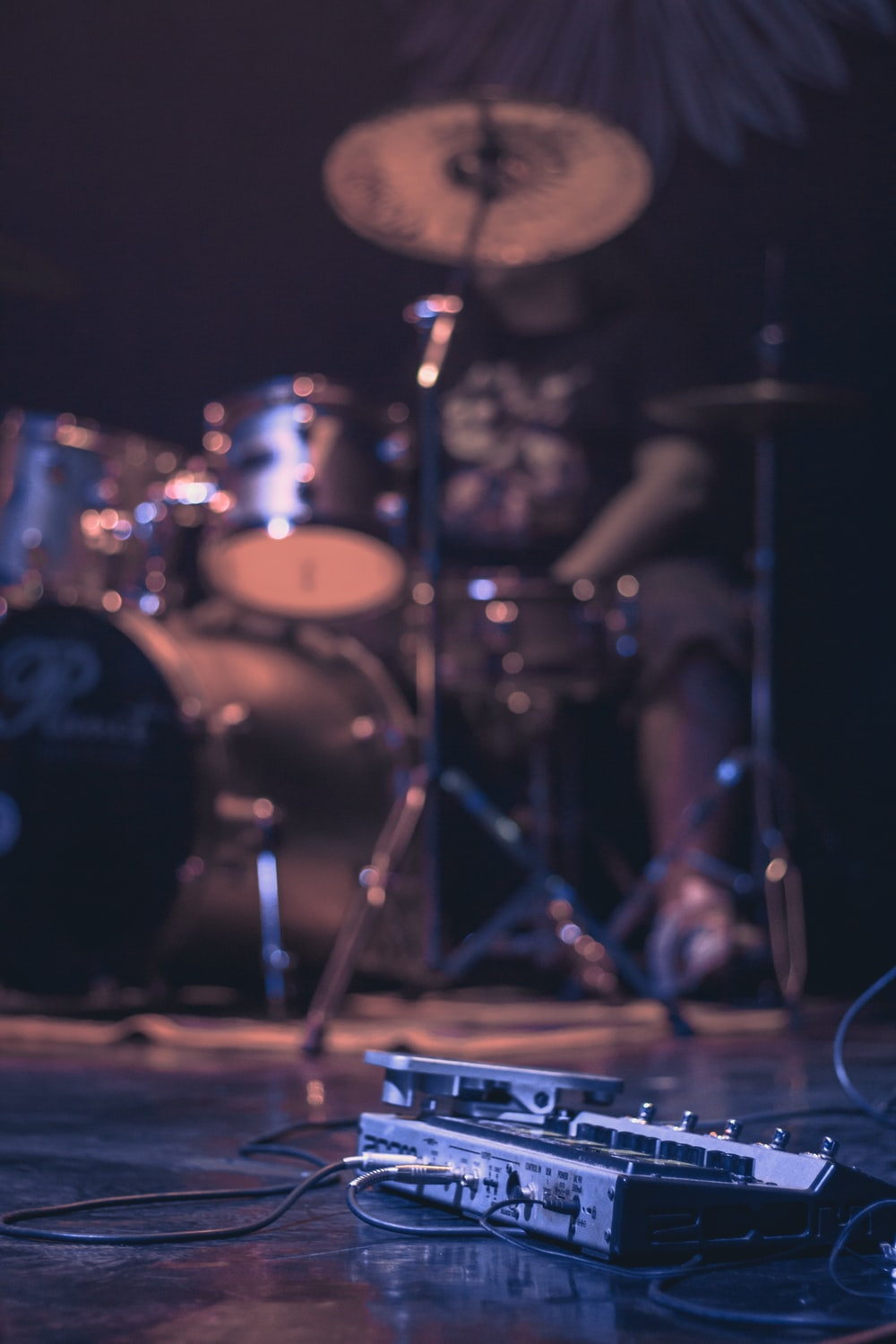 low-angle photography of man playing drum set
