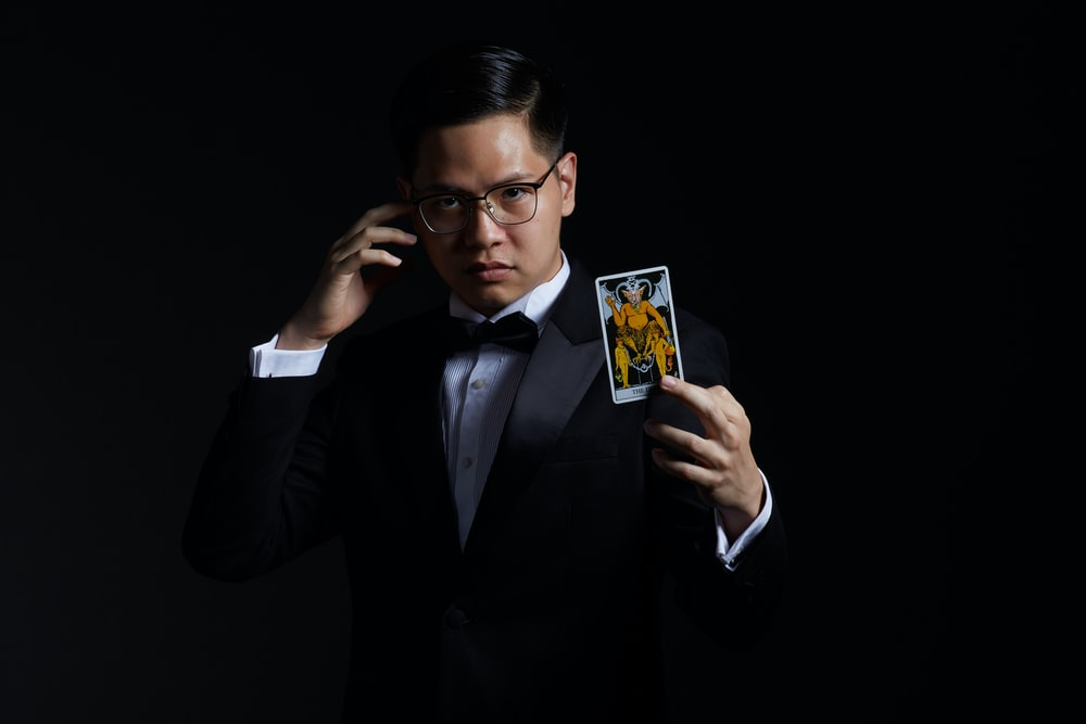 man holding card on focus photography