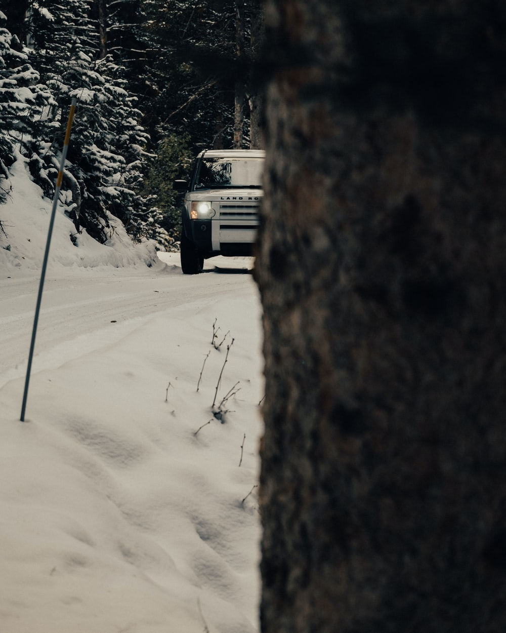 SUV on road covered with snow