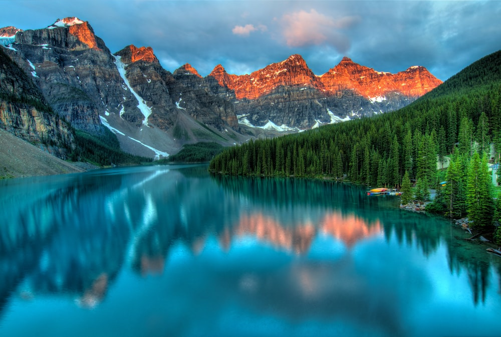 calm body of water and mountains wallpaper