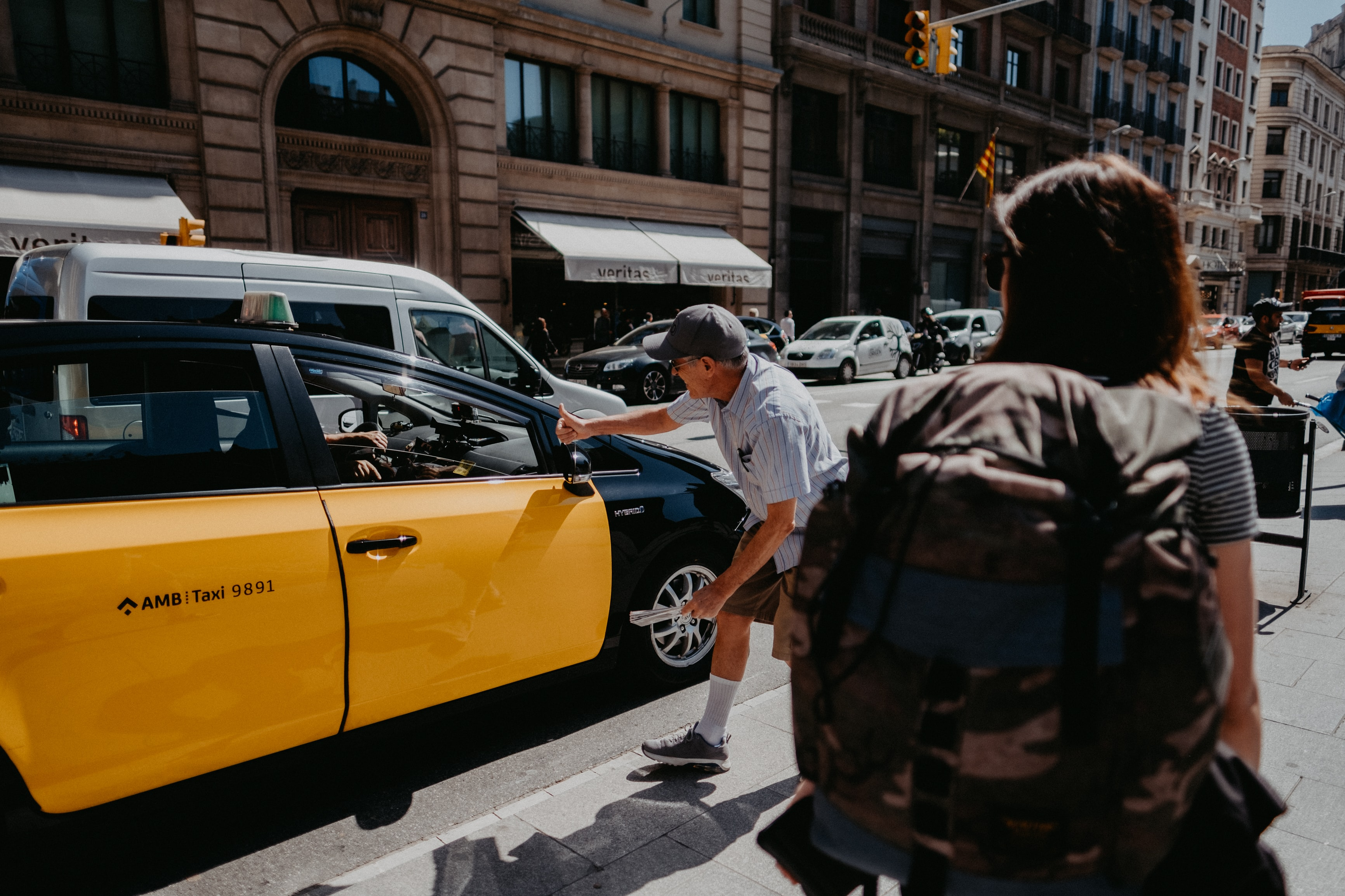 man near yellow and black car