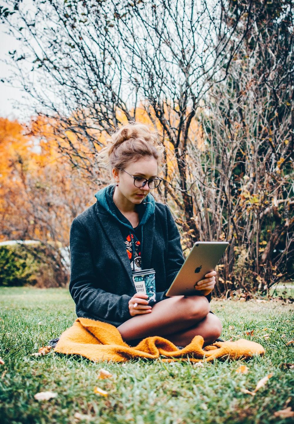 woman holding iPad