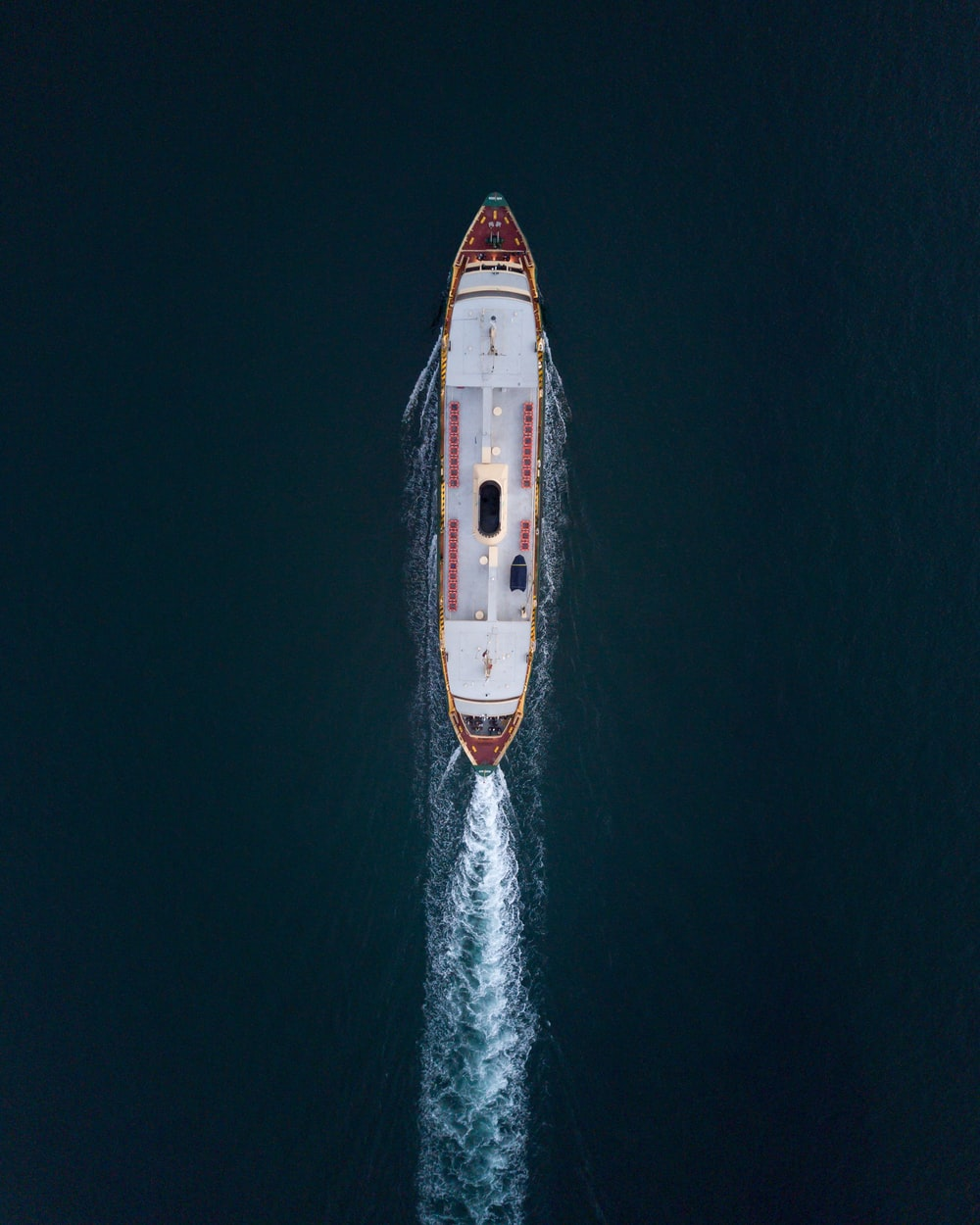 red and white ship on sea