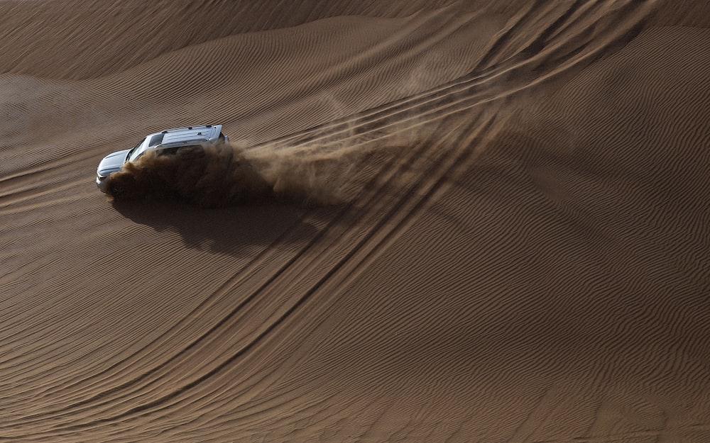 white SUV on desert