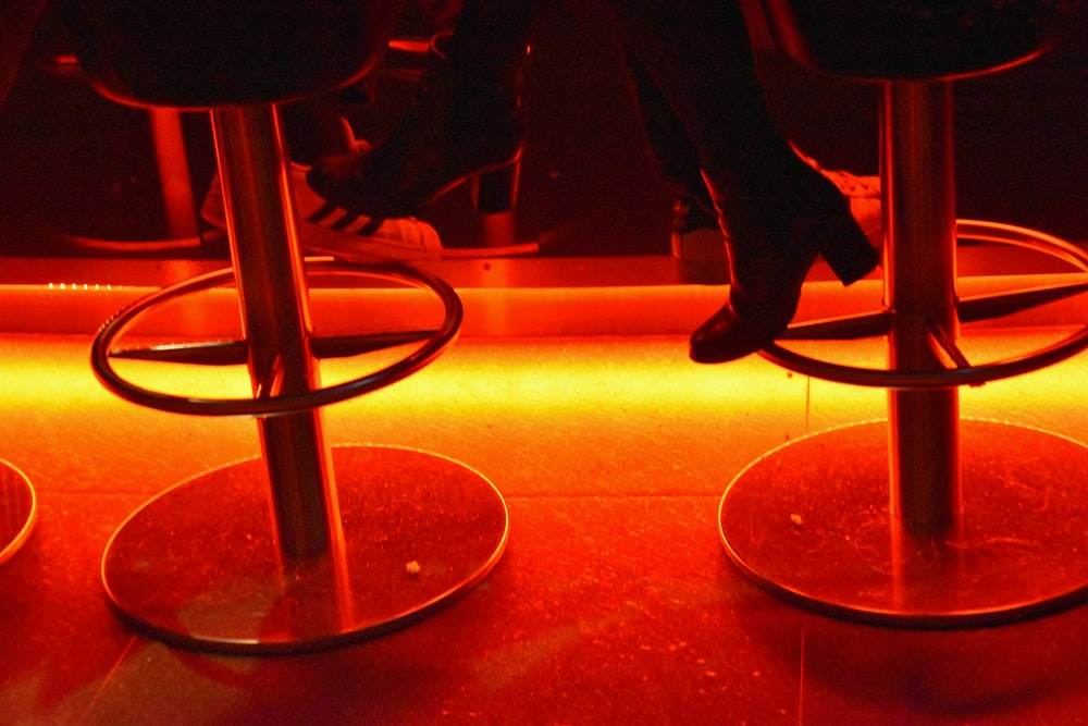 person sitting on bar stool