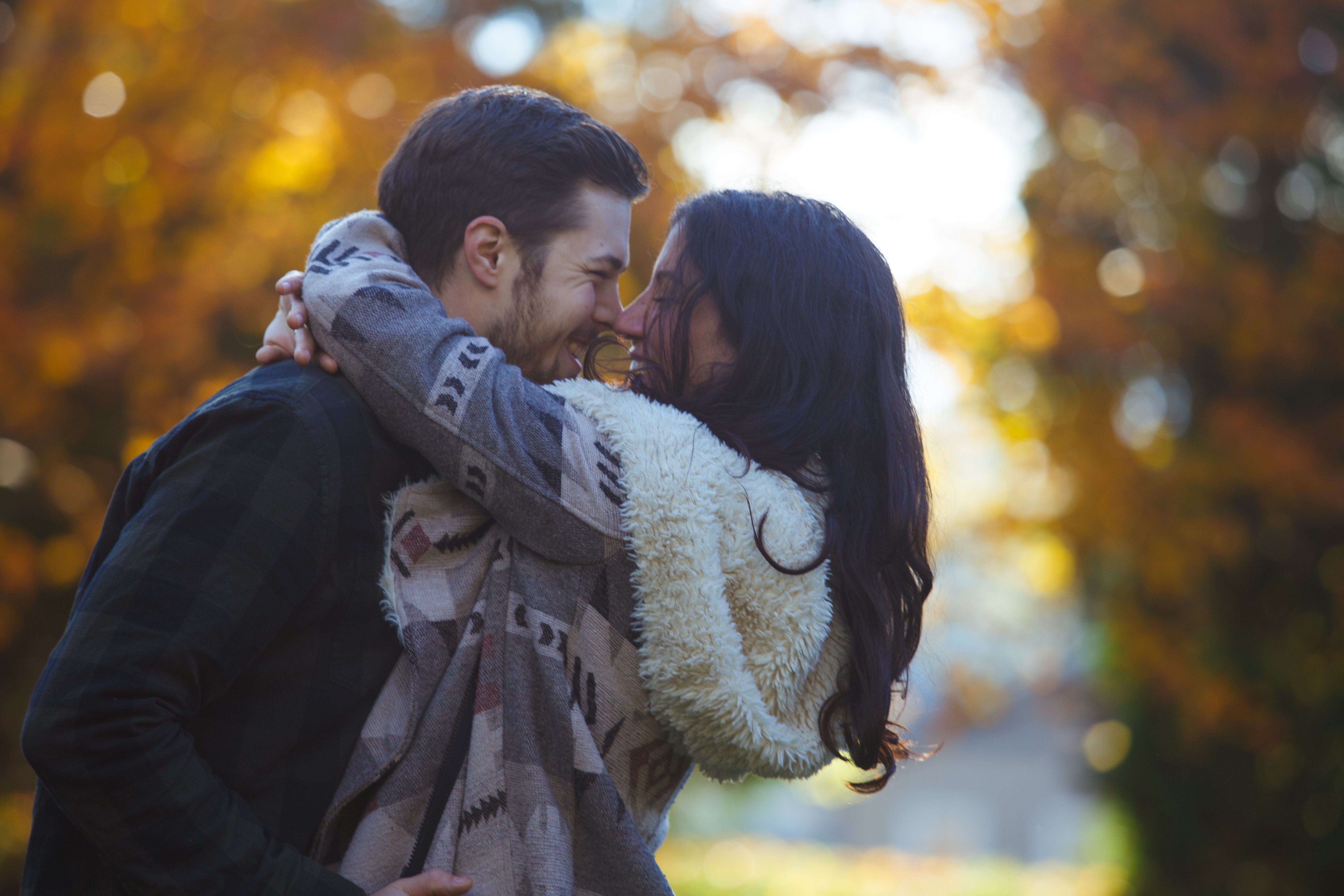 man and woman kissing outdoor