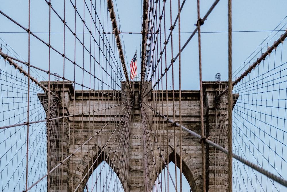 USA flag on Brooklyn Bridge during daytime