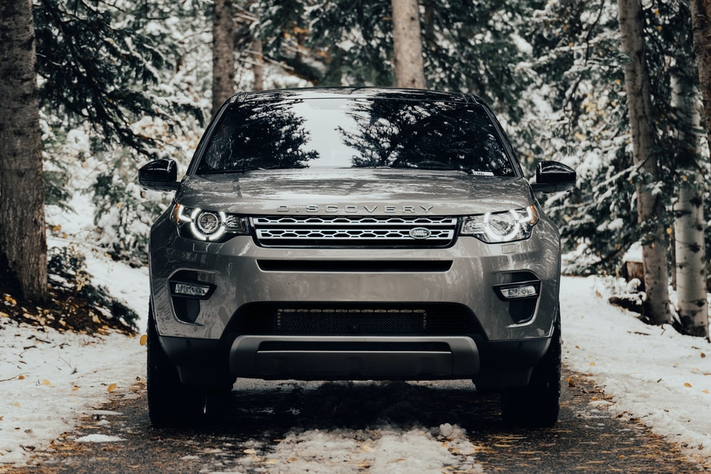 grey Land Rover vehicle on pathway