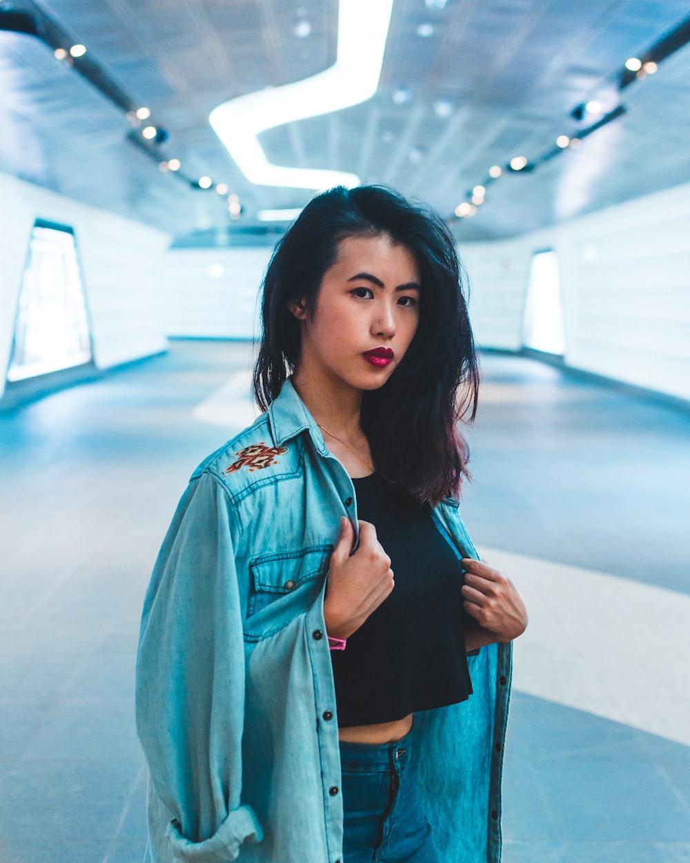 shallow focus photo woman in blue denim jacket