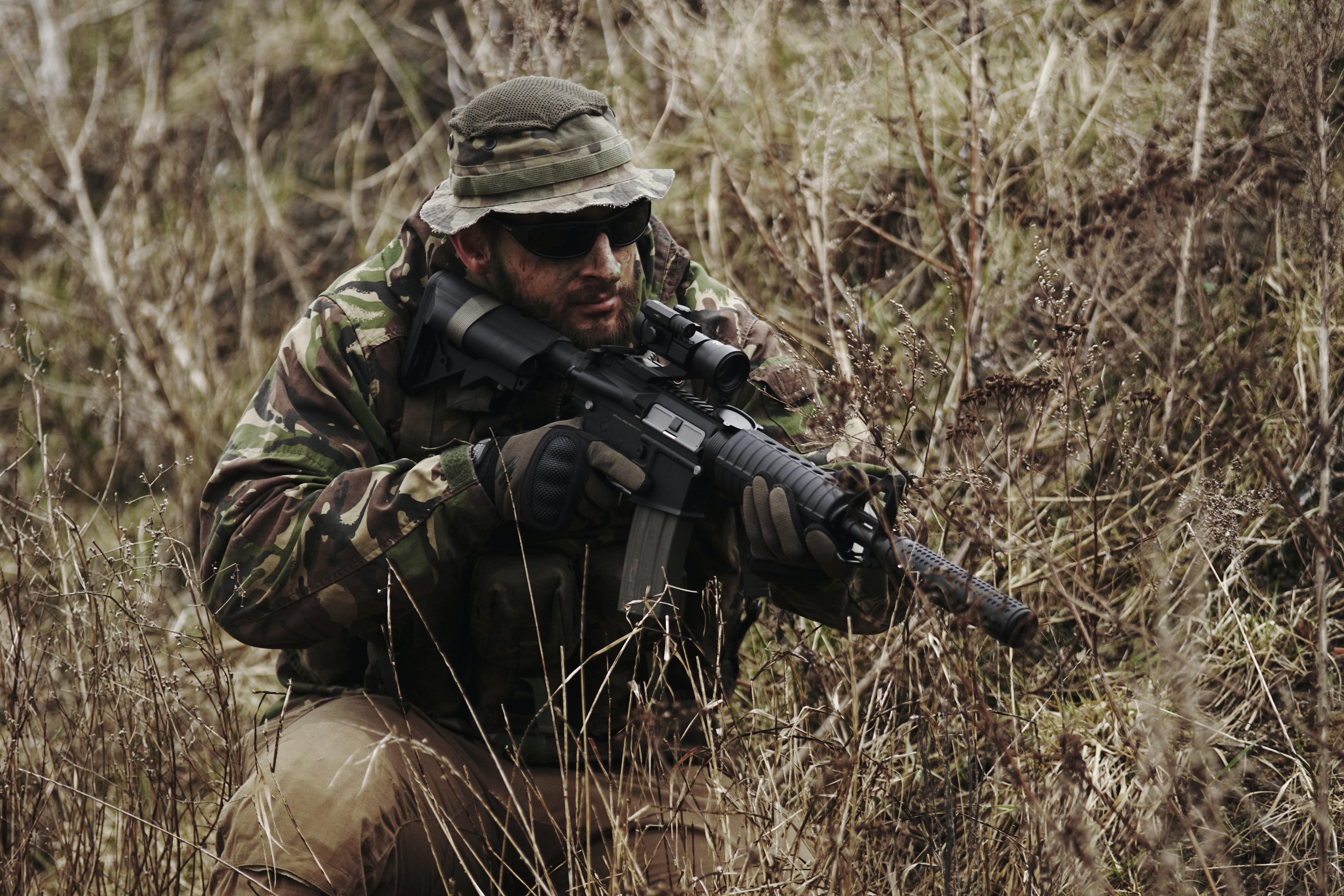 soldier holding black assault rifle