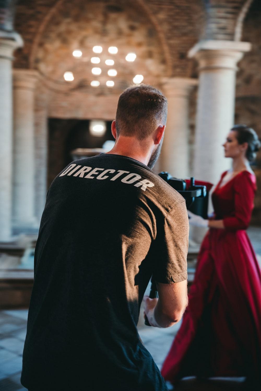 man wearing black Director t-shirt