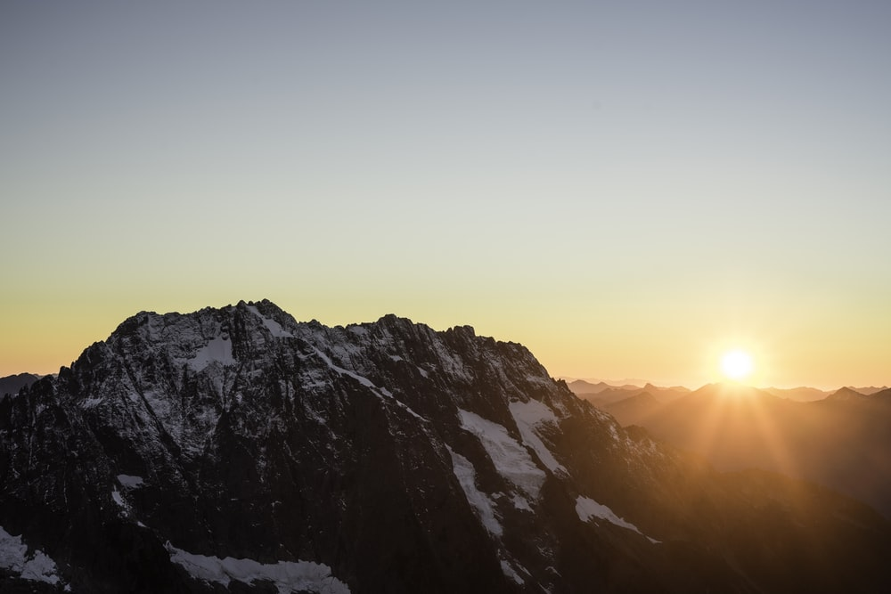snow covered mountain during sunrise