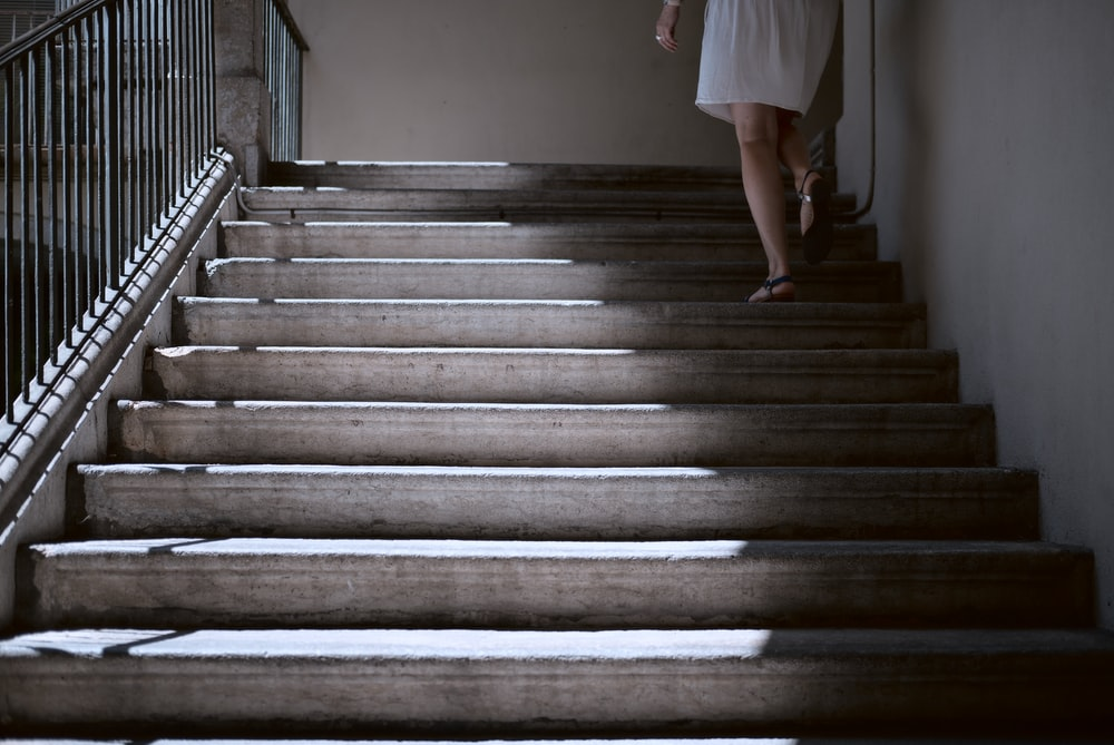 woman walking in stair