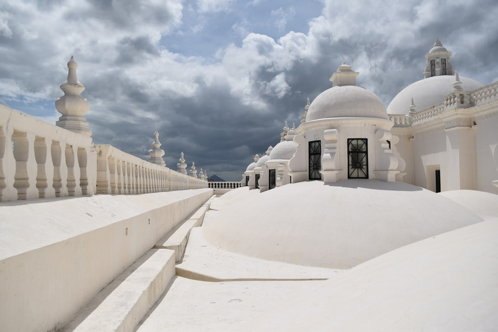 white dome building under cloudy sky