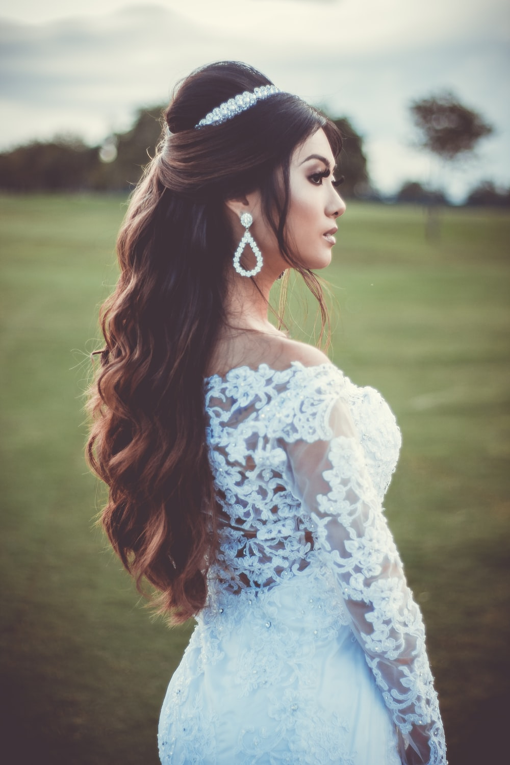 woman in white wedding dress standing on focus photography