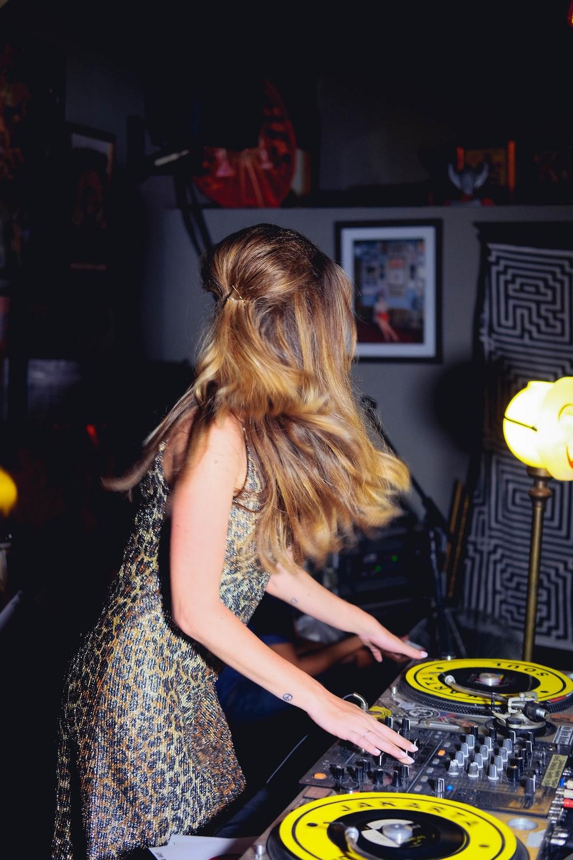 woman playing mixer at night