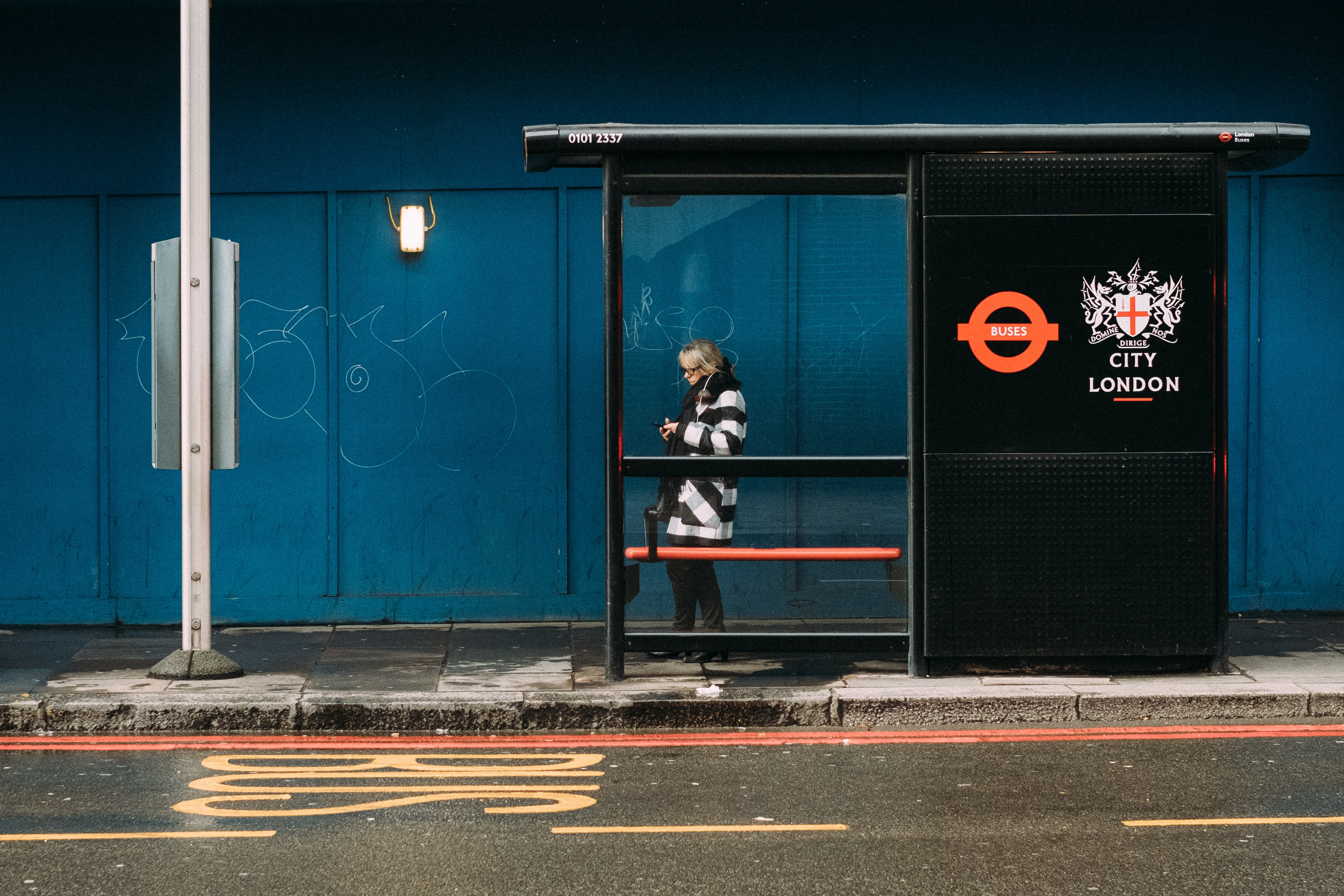 woman standing on waiting station