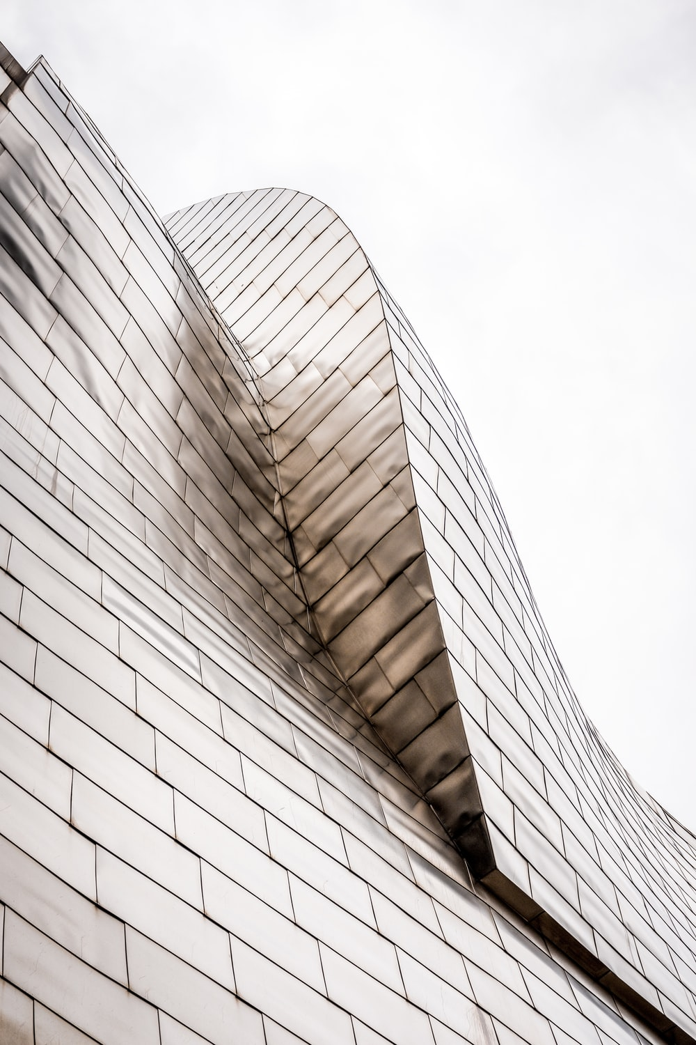 curved-top glass building under white sky