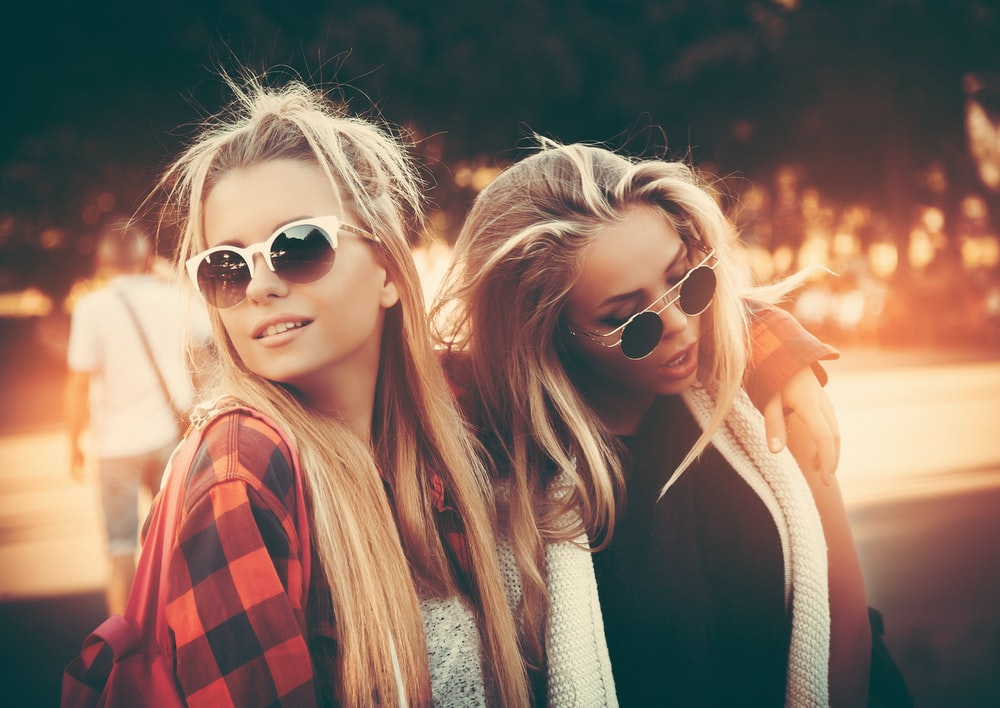 two women wearing sunglasses